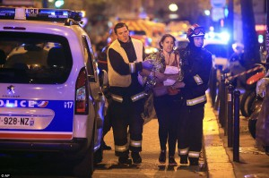 2E6F865100000578-3318838-Care_on_the_scene_Rescue_workers_help_a_woman_after_the_shooting-a-22_1447607475240