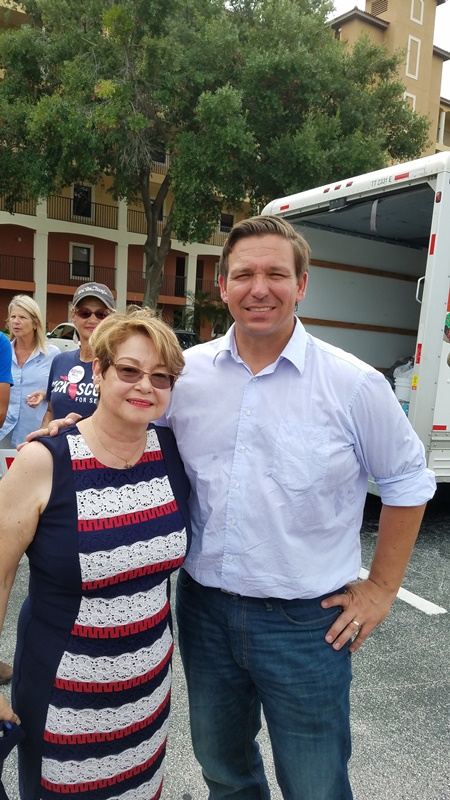 Ron DeSantis, candidate for governor of Florida was in Orlando this week working on the project of gathering water and food for the victims of hurricane, Michael. Amapola Hansberger, president of LIFA, was there as well.
